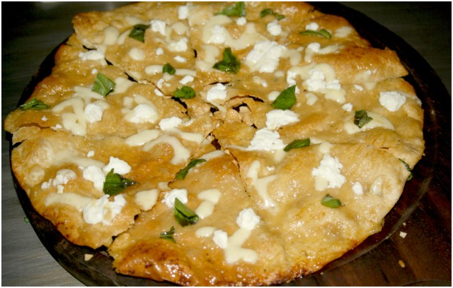 Bianco Pizza – Feta Cheese  with Garlic Confit and Basil.